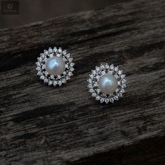 Pure silver studs that gives a beautiful look on women and girls of modern nature #silver #silverjewellery #pearls #pearljewellery #zirconiastones #studs #silverstuds #beautifulearrings #silverstore #pearlearrings #silverornaments #pearlstuds #earringswithpearls #stonedearrings #earringswithstone