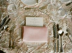 Glam Great Gatsby-inspired wedding - The linens and napkins from Creative Coverings were blush dupioni with an antique ivory rosette overlay.