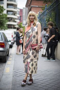 With a sari!! What a horrible way to wear it!!!