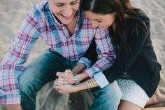 Chicago engagement photographers. Chicago wedding. Couples photography. Black and white photos. Happy couple in love. Toes in sand. Plaid dress shirt.