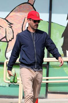 EXCLUSIVE: Sausage smuggler! Jon Hamm seen leaving the pet store with more than two sausages