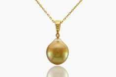 From our Classic Elegance collection comes this stunning 10mm Fiji-Gold Baroque pearl with peacock overtones.  Set in classic  14k Yellow Gold with one diamond (.006ct).  14k Rolo chain is included. (16 inches adjustable).  If you wish to purchase the pendent without the chain please request pendent price only.