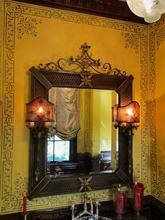 Fabulous color and wall stencil---I adore the stencil that creates another frame around the mirror