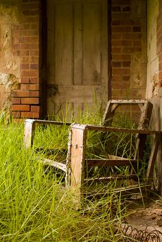 A rustic old chair at ruined farmhouse near Milang South Australia.