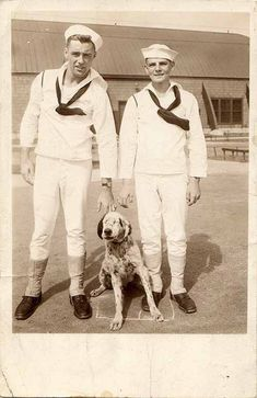 Vintage photo of two men and a dog