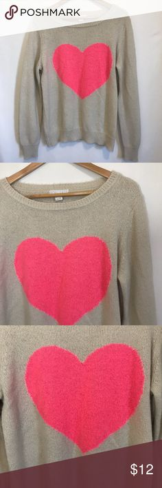 """Forever 21 pink heart sweater Great condition! Very comfortable and cozy. Perfect for those cold days! Has a light fuzzy material. Cream colored with pink heart design.  Measurements laying flat: • Bust 22"""" • Length 23.5"""" Forever 21 Sweaters Crew & Scoop Necks"""