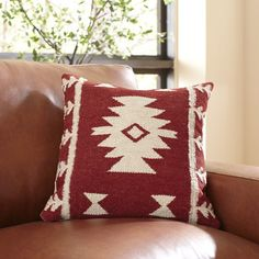 Carisa Pillow Cover | Add Southwestern-inspired flair to your decor with this red and white pillow cover, woven from all-natural jute and cotton.