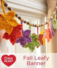 Fall Leafy Banner Free Crochet Pattern in Red Heart Super Saver yarn -- Crocheted leaves in gorgeous fall shades make the perfect banner. Whether you hang it at the window, on the mantel, above the bed or to add color to your work environment, you'll love having this banner this year and for years to come. Strung on hemp cord with wood beads gives it the perfect natural touch!