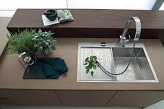 #LGLimitlessDesign & #Contest  Simple elegant sink with wood and silver accents.