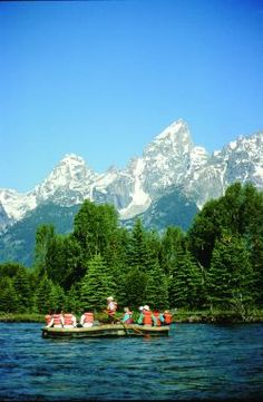 Snake River white water rafting in Wyoming with the Grand Tetons in the background.