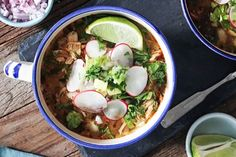 20-Minute Chicken Posole | 1 can (4.25 Ounce Can) Whole Green Chilies; 1 quart Chicken Stock; 1 Tbs Olive Oil; 1 Small Onion, Minced; 2 cloves Garlic, Minced; 1 tsp Dried Oregano; 1-½ tsp Ground Cumin; 1 tsp Chili Powder; 1 Shredded Cooked Chicken Breast; 1 15-Oz Can White Hominy, Drained And Rinsed; 1 pinch Salt; FOR GARNISH: 1 lime; 1 cup Chopped Romaine; 3 whole Radishes, Thinly Sliced; 1 Red Onion, Minced; 1 whole Avocado