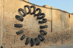 Octavi Serra, Iago Buceta and Mateu Targa created series of urban art installations titled Pneumatic made with cut salvaged tires. Modern Art, Contemporary Art, Art Cube, Tire Art, Cool Artwork, Amazing Artwork, Grid Design, Land Art, Art Festival