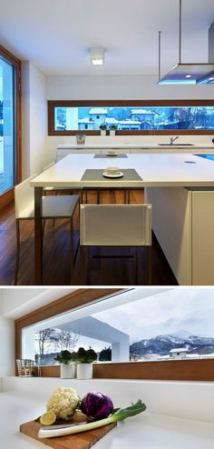 Cozinha com janela - 12 Inspirational Examples Of Letterbox Windows In Kitchens // This letterbox window sits just above the height of the counter and offers beautiful views of the mountains off in the distance. Home Decor Kitchen, Kitchen Interior, Long Kitchen, Kitchen Taps, Kitchen Modern, Bathroom Windows, Windows In Kitchen, White Countertops, Modern Dining Table