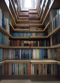 The bookcase/staircase is pure genius–using the once unused spaces under each stair as library and turning each into a separate nook to enjoy your favorite reads