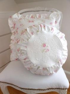 Furnishings: White Shabby Chic chair with pillows. by esther