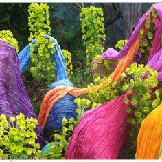 Shibori silk wraps on chartreuse leaves.