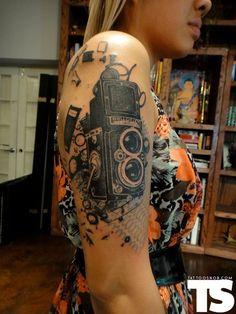 Camera Tattoo By Xoil Tattoo Design Tattoo Girls, Girl Tattoos, Tatoos, Music Tattoos, Kunst Tattoos, Body Art Tattoos, Portrait Tattoos, Bicep Tattoos, Great Tattoos