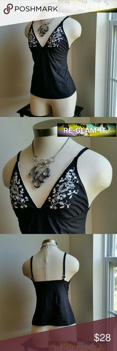 WHBM...BEAUTIFUL   EMBROIDERY ..TANK TOP ...GREAT CONDITION...... ...NORMAL WEAR ...NO FLAWS  ...BEAUTIFUL  ...A MUST HAVEEE  ...true to its size and color ...2 pic up close  ...TOP OR COULD BE USED AS A TANKINI ...PLEASE READ ...SIZE TAG REMOVED  ...IT'S A SMALL  ...embroidery design on front ...V chest front  ...backless ...flower designs  ...4 pic shows up close  ...comfortable  ...MTRL...adding soon ...better in person. ...NO OFFERS.. White House Black Market Tops Blouses
