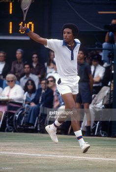 Arthur Ashe of The United States returns a shot during a men's singles match at the Wimbledon Lawn Tennis Championships circa 1975 at the All England Lawn Tennis and Croquet Club in London, England.