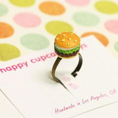Committed to making accessories as delectable as the people wearing them, Happy Cupcake Days cooks up hair clips, bobby pins, brooches, and rings that look like burgers, cupcakes (of course), moustaches, pandas, and more. Serve yourself a hearty helping of adornments you'll adore.