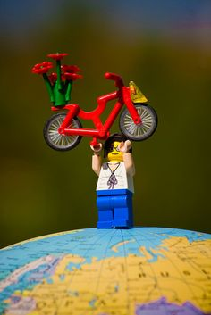 Lego cyclist on top of the world