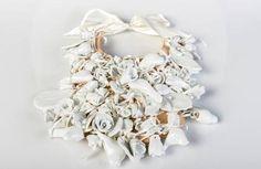 """Sarai Fdez. Marqués. """"Pechera de madera recubierta con piezas de porcelana y lazo de raso de seda"""" (2012). Wood, satin silk and porcelain."""