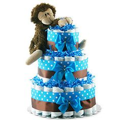 Enjoy your moment with this wonderful Baby Blue Diaper cake. With three Tiers this cake has everything you need for the perfect shower. Comes With: Diapers Desitin Cream Baby Bottle Plush Baby Baskets, Gift Baskets, Little Boy Blue, Baby Blue, Diaper Motorcycle Cake, Monkey 3, Diaper Cake Boy, Baby Bottles, New Baby Gifts