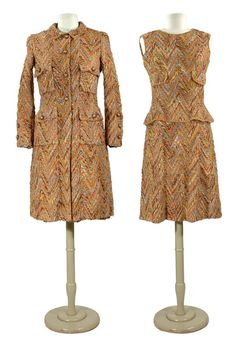 Chanel Chevron Tweed Dress Suit   French, 1960s   In marled autumnal copper tones flecked with dove gray, the sleeveless princess line short dress with ruffle peplum at hip, faux pocket flap either side on bodice, the cardigan coat with narrow collar, four flap patch pockets, each edge with cast-off stitch trim in self yarn, beige silk lining, brown buttons with gilt-metal centers