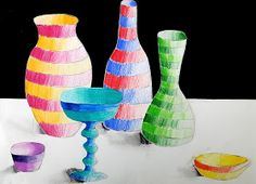 michela l.      Another exercise in light and shade for classes 2 (grade 7-8), made with colored pencils.When the bottles and jars are ...