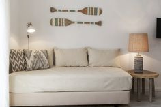 Have a twin bed mattress and box spring you are no longer using? Turn it into a twin bed couch. Cover with sheets, a throw or daybed cover. Add some pillows to the back and you have extra seating and sleeping options. Twin Mattress Couch, Daybed Couch, Diy Couch, Home Staging, Dusty House, Daybed Covers, Cama Box, Bed In Living Room, Home Remodeling Diy