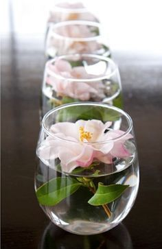 DIY Table Runner: If you have long tables at your wedding reception, adding wedding flowers in shallow glasses or vases is a lovely idea. Choose a flower that will lay flat (think ranunculus or a daisy rather than a peony or rose) for the best results.