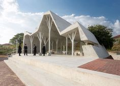 ron shenkin places concrete folded canopy over cemetery pavilion in israel