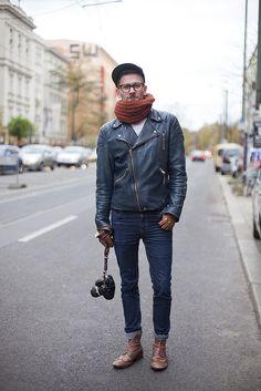 Shop this look on Lookastic:  https://lookastic.com/men/looks/biker-jacket-crew-neck-t-shirt-skinny-jeans-brogue-boots-baseball-cap-scarf-gloves/5352  — Black Baseball Cap  — Tobacco Knit Scarf  — White Print Crew-neck T-shirt  — Navy Leather Biker Jacket  — Brown Leather Gloves  — Navy Skinny Jeans  — Brown Leather Brogue Boots