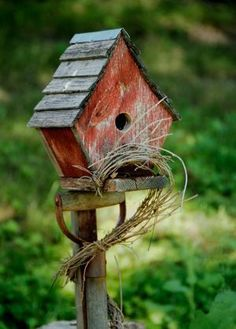 Rustic Bird House  A rustic bird house adds much to a country garden and can be very entertaining when a bird family moves in.  You can easily build a bird house or purchase a rustic looking one. #buildabirdhousekit