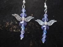 """Hand-Made Blue Crystal Angel Ear-rings $7This is a hand made pair of Swarovski Blue Crystal Angels is a  simple yet elegant design.  The idea was inspired by my love of Angels, and my love affair with Swarovski Crystals.  Measurements are with hooks total lenght 1"""", total width 1"""" making these beauties the perfect length for short or long hair.    Tibetan Silver Angel Wings surrounded by the body made with Genuine Swarovski Crystals so well known for their their beauty and Brilliant Shine."""