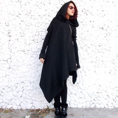 Asymmetric extravagant black coat. Extra Long Wool jersey Sleeves and Wool Jersey Hood. No lining. Extravagant and Unique Black Asymmetrical Coat. With Zip in front. Comfortable and always in Style!