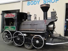 Choo Choos BBQ. The train is actually a smoker with four rotating racks inside. The owner built it himself, and even including a working train whistle and bell! Best #BBQ in #WNC! - at our Customer Appreciation Day Event May 16, 2013.  #Man #Cave #Garage #Grills