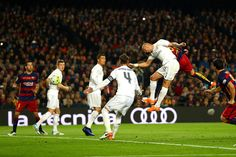 Gerard Pique of FC Barcelona scores the opening goal during the La Liga match between FC Barcelona and Real Madrid CF at Camp Nou on April 2, 2016 in Barcelona