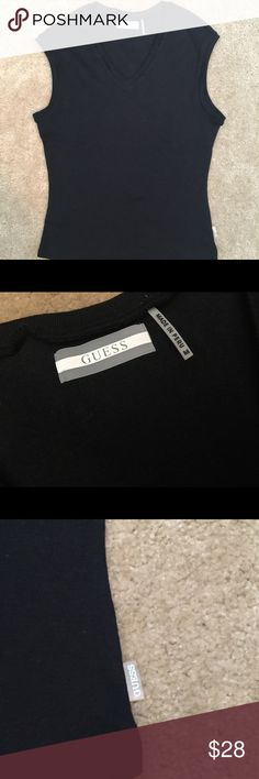Guess V-Neck shirt Black v-neck, used a few times / Still has a lot of life in it / The top ends below the belly button / GREAT CONDITION / the bottom is rounded out, not straight G by Guess Tops Tank Tops