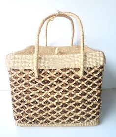 """Planning to have a picnic with family or friends this weekend? Take this picnic basket as your essential for your next outdoor gathering. It's made from natural fiber (ABACA), so it's 100% eco-friendly and durable.  Php. 770.00 Dimension – Height: 12"""" Width:14""""  #livefair #lifthumanity #philippineartisans #our7107islands #wearFilipino #lovewithacause #philippines #handmade #handicrafts"""