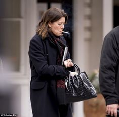 Incognito: Puffing away on a cigarette, Princess Caroline blended in with the everyday folk as she went about her business in the capital