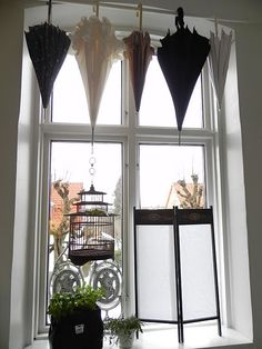 Here's something a little different -umbrellas as window treatment...hmmm