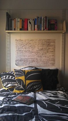 I absolutely love the poster above the bed. That could be such a simple DIY too! The shelf is great as well!