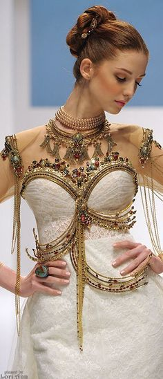 Gaudy amazingness. More can *so* be more. (Dar Sara Couture Bride 2014 )
