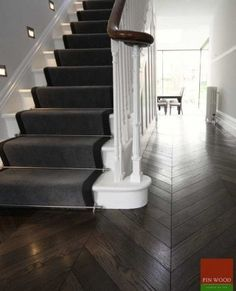 This dark chevron wooden flooring that we fitted in this hall links in with the dark border of the stair runner.