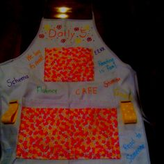 This is a Daily 5 teaching apron I use in my first grade class. The ribbon hooks hold our sight words and all the pockets hold all my daily 5 goodies.