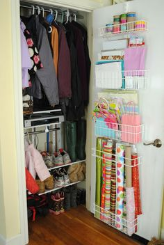 Make every inch count in a small coat closet - see how jackets, shoes, and gift wrap supplies are all neatly corralled here!