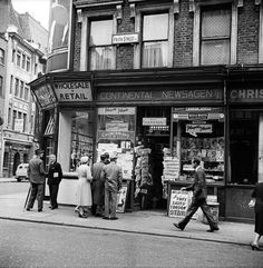 Studying the latest news. Frith Street, London. June 1956
