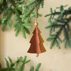 Christmas Tree Ornament   Martha Stewart Living — Simply cut, glue, and tie off the ends.