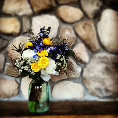 Yellow, white, blue and greens in this hemp twine wrapped bouquet sitting in a blue mason jar.  This was for a wedding at the Lodge and Spa in Breckenridge.  #breckenridge #florist #bridalbouquet #bouquet #wedding #flowers #colorado #sumco